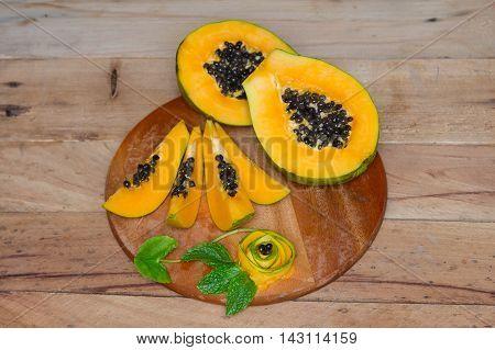 Ripe sweet papaya on green background. Papaya