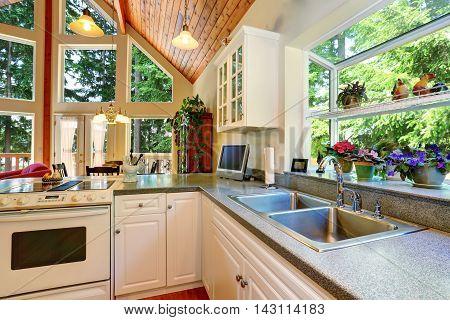 Classic American White Kitchen Interior With Granite Counter To