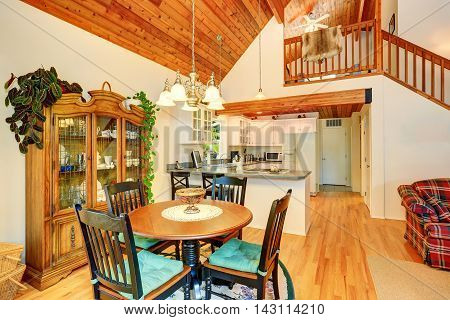 Traditional Dining Area With Wooden Table Set And Hardwood Floor.