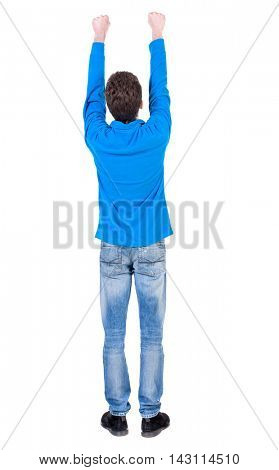 Back view of  man.  Raised his fist up in victory sign.  Rear view people collection.  backside view of person.  Isolated over white background. Curly boy in the blue jacket raised his hands up.