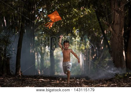 The boys are flying kites by running the lives of children in rural areas.