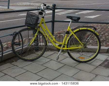 STOCKHOLM SWEDEN - CIRCA JUNE 2016: yellow bicycle aka bike or cycle parked