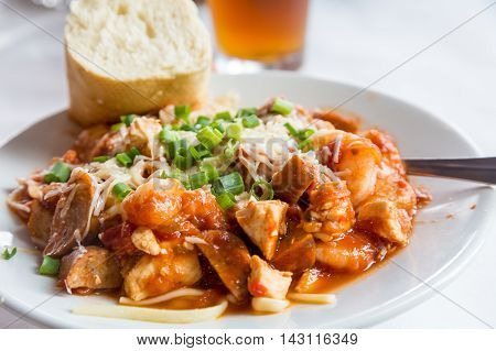 A bowl of Seafood Jambalaya with french bread