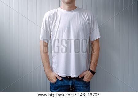 Casual man in jeans trousers and white t-shirt as copy space for shirt print graphic design mock up