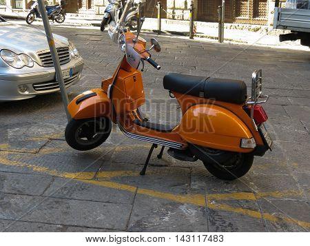 Orange Vespa Motorbike In Florence