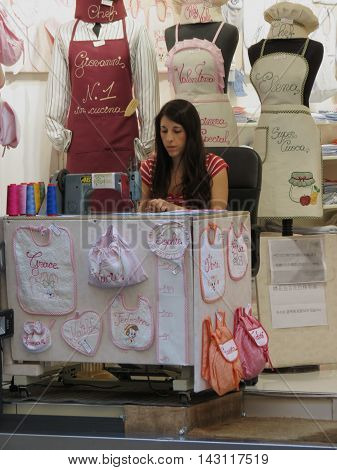 Young Woman Sewing In Florence
