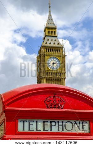 Public telephone sign in front of the Big Ben in London United Kingdom