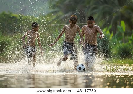 Boy kicking a soccer ball, Children kick a stream Funny