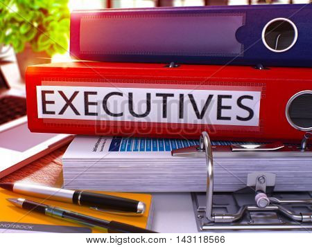 Executives - Red Ring Binder on Office Desktop with Office Supplies and Modern Laptop. Executives Business Concept on Blurred Background. Executives - Toned Illustration. 3D Render.