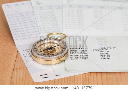 Saving account from bank and old compass