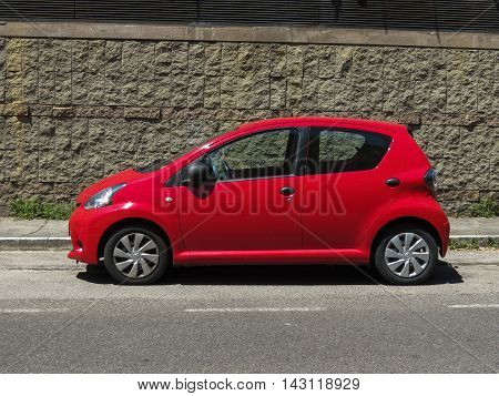 SIENA ITALY - CIRCA JULY 2016: red Toyota Yaris car parked in a street of the city centre
