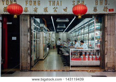 KUALA LUMPUR MALAYSIA - MARCH 17: Man buys medicine in traditional Chinese medicine store in Chinatown on March 17 2016 in Kuala Lumpur Malaysia