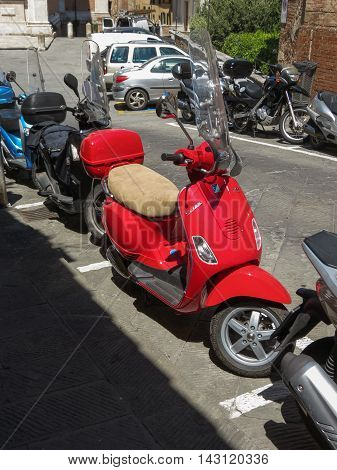 Red Vespa Motorcycle In Siena