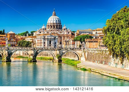 Rome Italy. Vatican dome of Saint Peter Basilica (Italian: San Pietro) and Sant Angelo Bridge over Tiber river.