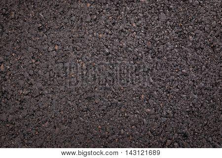 Background texture of rough asphalt road concept.