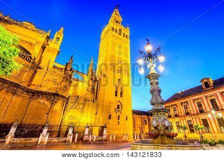 Seville Andalusia Spain. Cityscape twilight image with Santa Maria de la Sede Cathedral and Girdala