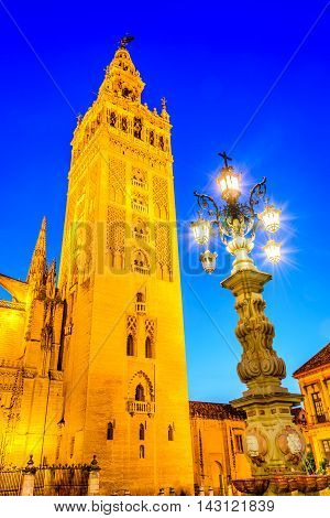 Seville Andalusia Spain. Cityscape twilight image with Santa Maria de la Sede Cathedral and Girdala