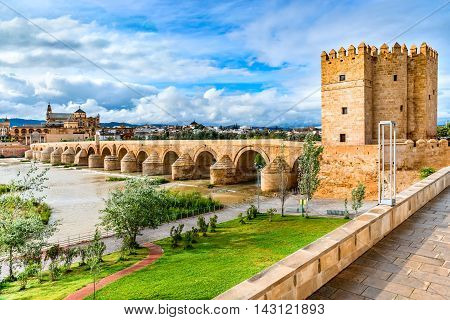 Cordoba Spain. Roman Bridge on Guadalquivir river and The Great Mosque (Mezquita Cathedral) at twilight in the city of Cordoba Andalusia.