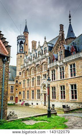 Bruges Belgium. Medieval brickwork building in downtown historic center of Brugge gothic city in West Flanders.
