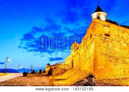 Brasov Romania - Stunning twilight HDR image with medieval hilltop fortress of Corona - The Citadel Transylvania