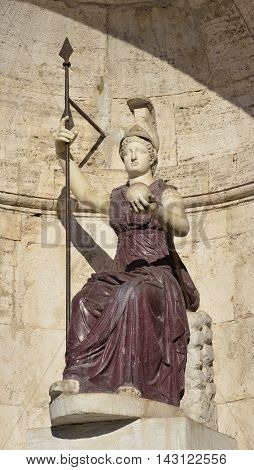Ancient marble and porphyry statue of Minerva as Goddess Roma with lance and globe in Capitol Square Rome