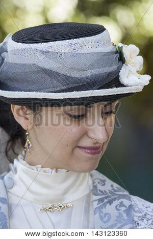 CAGLIARI, ITALY - June 1, 2014: Sunday at La Grande Jatte public gardens - Sardinia - portrait of a beautiful woman in Victorian costumes