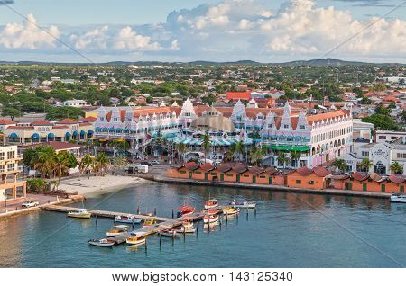 Oranjestad Aruba - December 01 2011: View from above of colorful buildings in Oranjestad on the island of Aruba in the morning sun at December 01 2011.