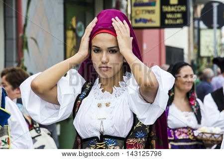 SELARGIUS, ITALY - September 13, 2015: Former marriage Selargino - Sardinia - portrait of a beautiful girl in traditional Sardinian costume folk group Santa Mariaquas of Sardara.