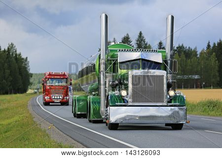 URJALA, FINLAND - AUGUST 11, 2016: Peterbilt 359 year 1971 of Fredrik Biehl moves along highway in convoy on the way to the annual trucking event Power Truck Show 2016 in Alaharma Finland.