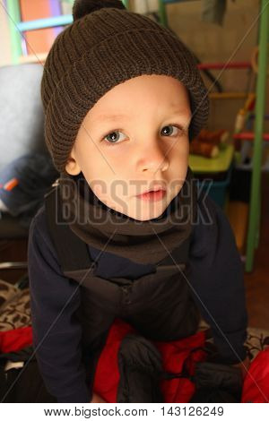 Little Boy Dressed In Warm Clothing At Home.