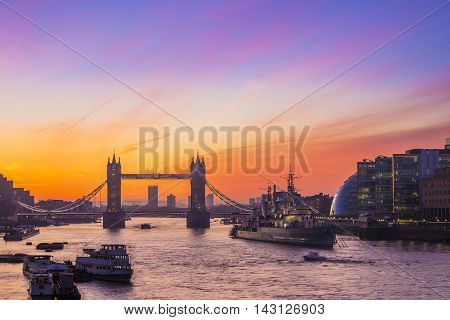 London, England - Tower Bridge and HMS Belfast cruiser at sunrise with amazing sky