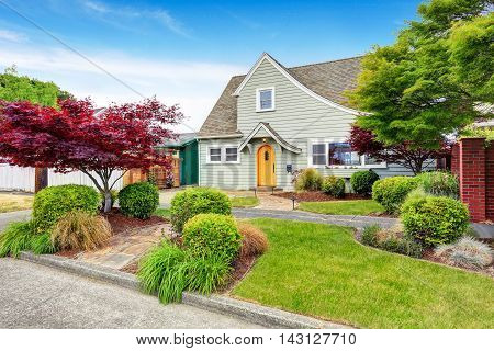Classic American House Exterior With Nice Landscape Desing.