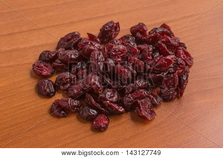 Close-up on a Dried Cranberries over a wooden table