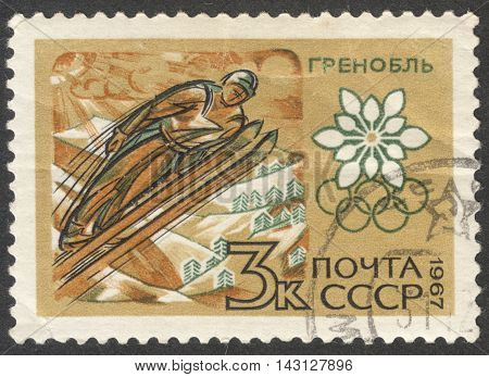 MOSCOW RUSSIA - CIRCA JUNE 2016: a post stamp printed in the USSR shows a flying skier the series
