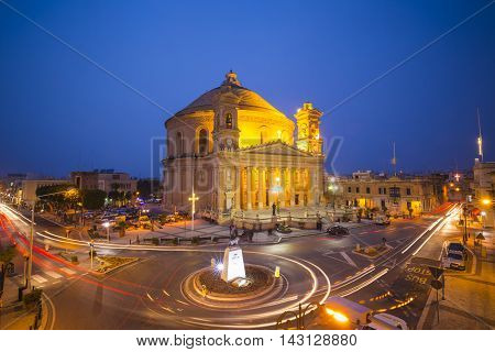 Malta - Beautiful Mosta Dome with traffic lights at blue hour