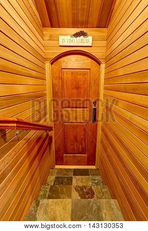 Hallway Interior With Pannel Wooden Trim. Door To Home Wine Cellar.