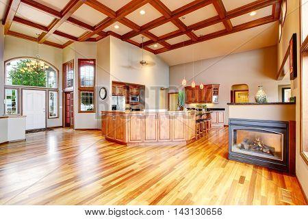 Kitchen And Living Room With Hardwood Floor, White Entrance Door.
