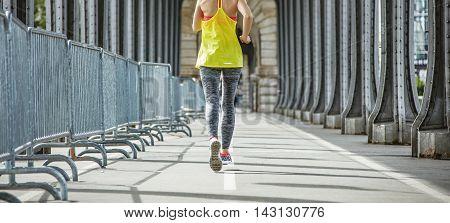 Sportswoman Jogging On Pont De Bir-hakeim Bridge In Paris
