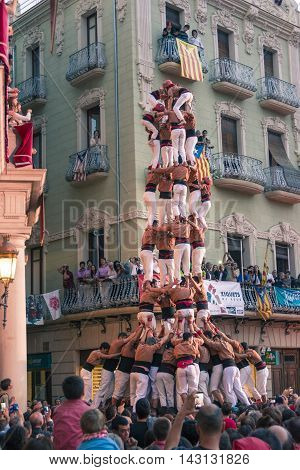 Reus, Spain. October 3, 2015: Castells Performance, a castell is a human tower built traditionally in festivals within Catalonia. This is also on the UNESCO Intangible Cultural Heritage of Humanity