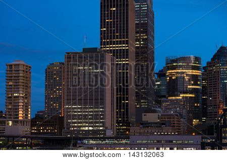 Modern cityscape at evening background. Skyscrapers of Sydney downtown at blue hour. Copy space long exposure