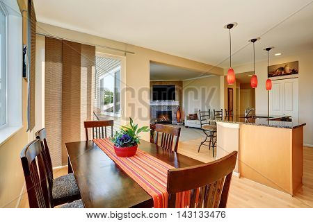Dining Area With Wooden Table Set. Open Floor Plan.