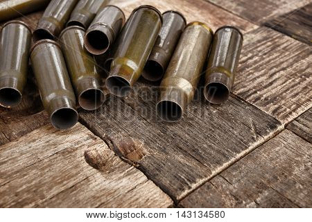 Bullets shells on wooden background.macro.