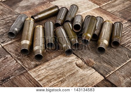 Bullets shells on wooden background. macro.