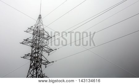 transmission tower silhouette in mist white background