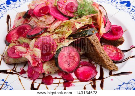Red beetroot salad with pickles and croutons
