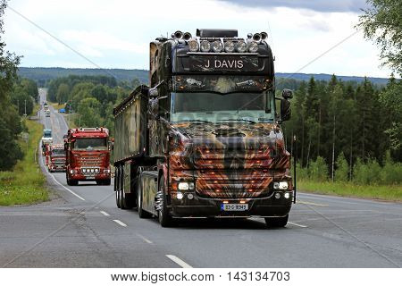 IKAALINEN, FINLAND - AUGUST 11, 2016: Customized Scania T580 Resident Evil of J Davis Ireland moves along scenic road in truck convoy to Power Truck Show 2016 in Alaharma Finland.