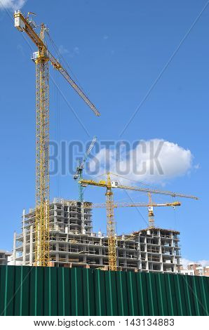 Tower crane working on a construction site construction of a house tower crane against the sky construction machinery building house