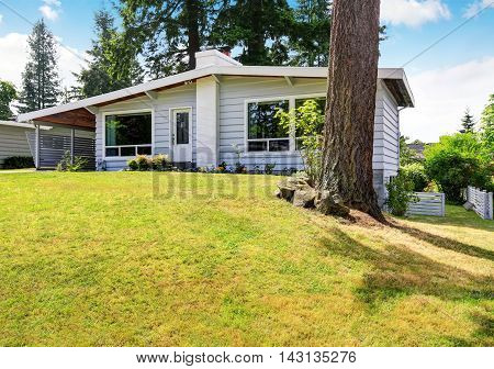 One Level House With Siding Trim And Well Kept Lawn
