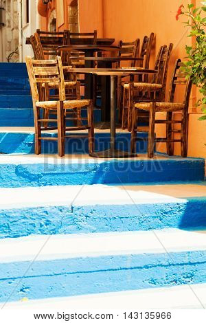 Old staircase and street coffee shop in summer Crete impressions of Greece
