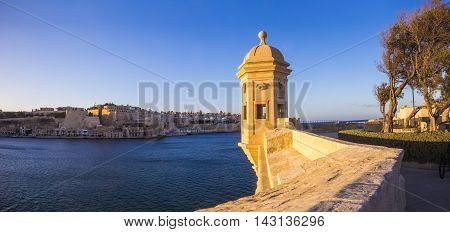 Malta - Watch tower and the walls of Valletta at Gardjola Gardens in Senglea at sunset